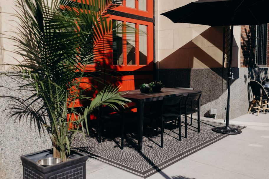 Patio table for 6 with Umbrella by it at our downtown Detroit restaurant - apparatus room